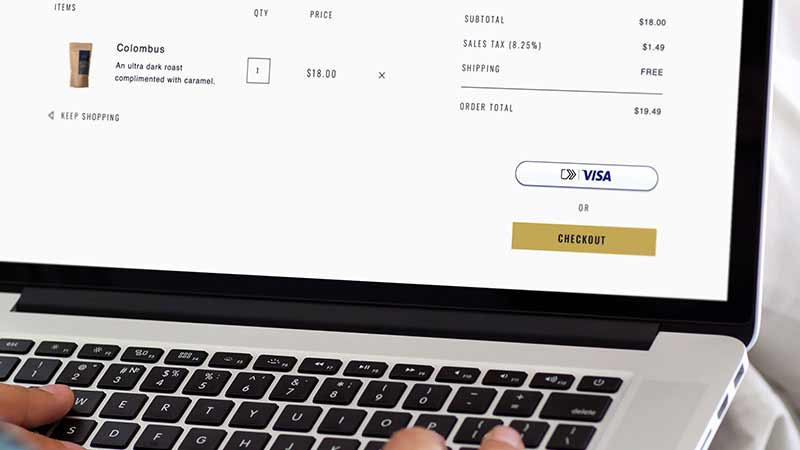 Closeup on a laptop screen that shows the new checkout experience.
